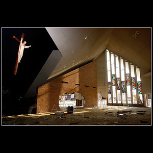Paul Conrad/The Aspen Times  A crucifix watches over the remains of St. Paul's Catholic Church in Pass Christian, Miss. The stained glass windows of the Apostles remained intact while the others shattered from the wind.