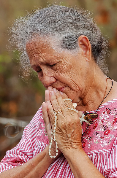 ©Paul Conrad/The Aspen Times - Ana Weidie of Pearlington, Miss., prays during Sunday morning mass at St. Joseph's Catholic Church in Pearlington October 2, 2005. Weidie's 200-year-old home was heavily damaged by the storm surge when Hurricane Katrina roared ashore August 29.