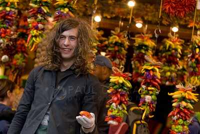 © Paul Conrad/ Pablo Conrad Photography  Joshua Cummings peddles his wares while at Choice Produce & Peppers at Pike Place Market in Seattle, Wash.