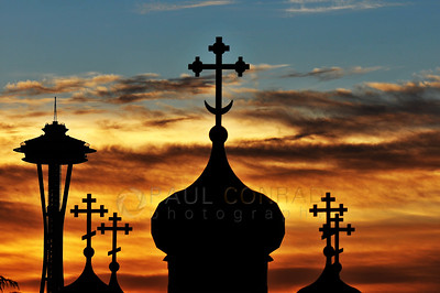 © Paul Conrad/ Pablo Conrad Photography  The setting sun silhouettes the crosses at St. Spiridon Orthodox Cathedral and the Space Needle in Seattle, Wash.