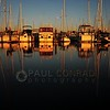 © Paul Conrad/ Pablo Conrad Photography<br /> <br /> The setting sun lights the boats at the Everett Marina north of Seattle, Wash.