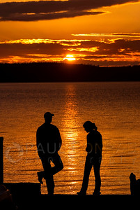 © Paul Conrad/ Pablo Conrad Photography  Lovers in the sunset on Camano Island north of Seattle, Wash.