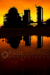 © Paul Conrad/ Pablo Conrad Photography  Old structures are reflected in a puddle at Gasworks Park on the north shore of Lake Union in Seattle, Wash.