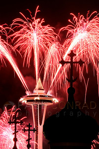 © Paul Conrad/ Pablo Conrad Photography  Fireworks explode over the Space Needle silhouetting the crosses at St. Spiridon Orthodox Cathedral as the New Year is welcomed in Seattle, Wash.