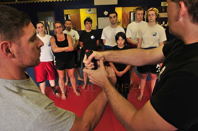 © Paul Conrad/Pablo Conrad Photography - Arjhan David Neal Brown teaches gun disarming techniques  during the PNW Muay Thai camps at Total Confidence Martial Arts in Bellingham, Wash., on Wednesday afternoon Aug. 28, 2013.