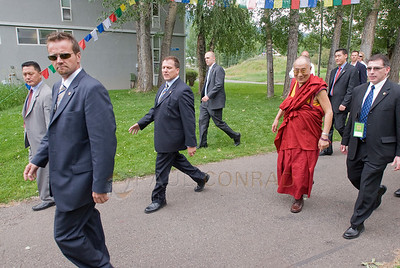 ©2009 Paul Conrad/Pablo Conrad Photography  Secret Service agents escort His Holiness the14th Dalai Lama after his keynote speech at the Aspen Institute in Aspen, Colorado.  Send Me Your Thoughts and Questions