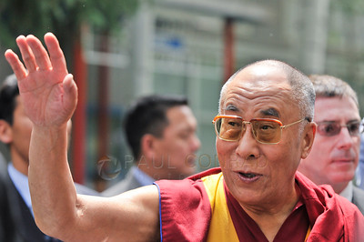 ©2009 Paul Conrad/Pablo Conrad Photography  His Holiness the14th Dalai Lama waves to the crowd after his keynote speech at the Aspen Institute in Aspen, Colorado