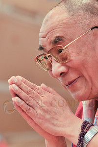 ©2009 Paul Conrad/Pablo Conrad Photography  His Holiness the14th Dalai Lama greets the audience before his keynote speech at the Aspen Institute in Aspen, Colorado.