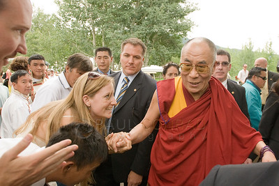 ©2009 Paul Conrad/Pablo Conrad Photography  His Holiness the14th Dalai Lama is hounded by followers and admirers after his keynote speech at the Aspen Institute in Aspen, Colorado.