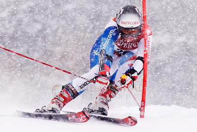 © Paul Conrad/Pablo Conrad Photography Austrian ski racer Eva Maria Brem hits a gate during her first run at the Aspen Winternational FIS World Cup in Aspen, Colo.