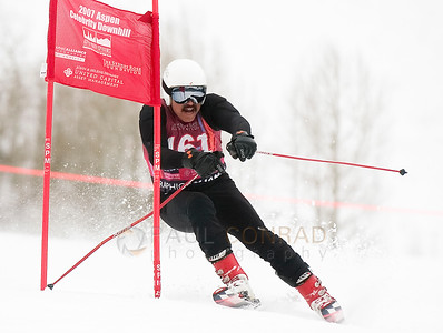 © Paul Conrad/Pablo Conrad Photography Judge Joe Brown takes a gate Saturday morning during the annual Aspen Youth Experience Celebrity Downhill fundraiser on Little Nell.