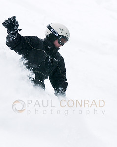 © Paul Conrad/Pablo Conrad Photography A snowboarder charges the fresh powder on the Back of Bell in Aspen, Colo.