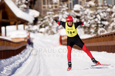 © Paul Conrad/Pablo Conrad Photography Noah Hoffman of Aspen, Colo., crosses the Tiehack pedestrian bridge nearly a full minute before the next racer during the 21st annual Owl Creek Chase in Aspen. Hoffman finished the 25km course in 1:05:21.5, earning him first place in the men's elite division. The annual ski race begins in Snowmass Village and winds its way through the Elk Mountains finishing in Aspen.