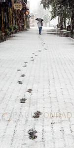 © Paul Conrad/Pablo Conrad Photography A pedestrian leaves tracks in fresh snow while walking along the Hyman Avenue Mall in Aspen, Colo.