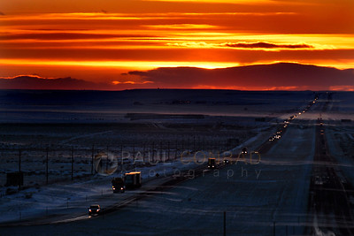 © Paul Conrad/Pablo Conrad Photography The sun sets as blowing snow crosses Interstate 80 in southern Wyoming in February 2011.