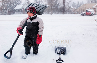© Paul Conrad/Pablo Conrad Photography Taking a pause while tackling the daunting task of shoveling over 2 feet of snow, Gianni Giordano of Aspen, Colo., looks around at all the falling snow in front of Tullio Salon on East Main Street in Aspen.