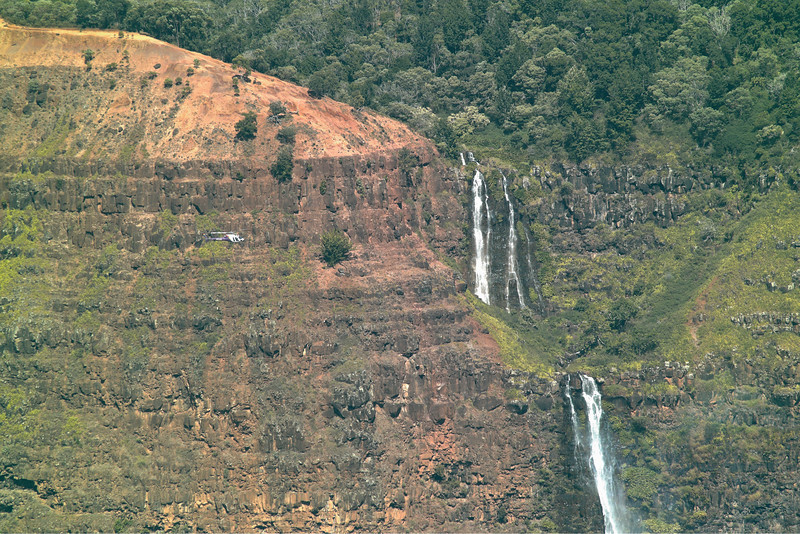 Tourist Helicopter Passing By Waipo`o Falls in Waimea Canyon, Kaua`i, Hawaii