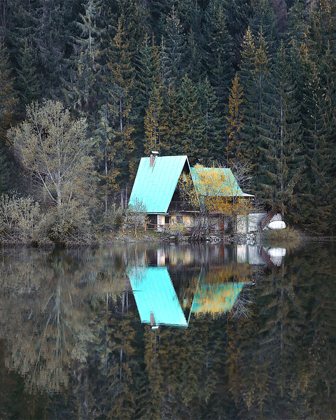A cabin and a placid lake surrounded by pine tree scent. What else?  Palcmanskà Pleso, Slovakia