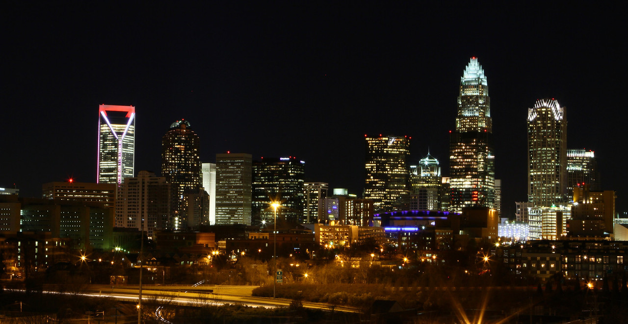 Charlotte NC at night. The skyline has seen the addition of a new building like the beautiful Duke Tower to the left