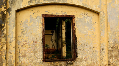 The window of an abandoned railway station in Porus, Jamaica. I have been driving across the country and documenting the decline of local infrastructure. .