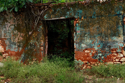 A section of an old abandoned building in rural Jamaica. I have been driving across the country and documenting the decline of local infrastructure. The photograph may have vibrant colors but it belies the desperate conditions in most rural areas of the country.