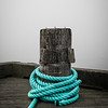 Rope coiled around bollard in fog. Halifax, NS.