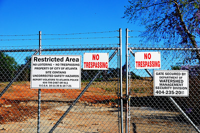 More signs on more barbed-wire fences. Edited.