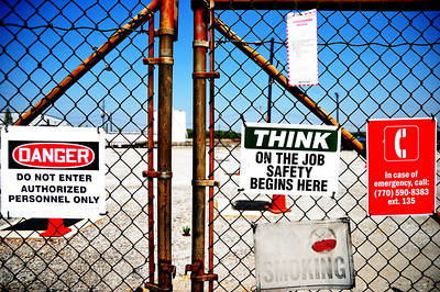 Some signs on some gates. Edited.