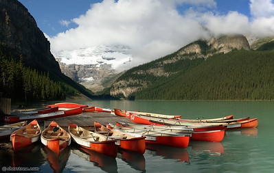"""Ready for the day""  Every morning these canoes are set out on Lake Louise for people to rent."