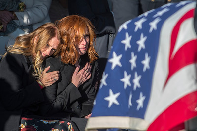 Taylors mom, Tammy consoles Jennie Taylor, wife of Maj. Brent R. Taylor mourns during the funeral services, at the Ben Lomond Cemetery in North Ogden ,on Saturday, Nov 17, 2018.