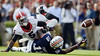 Auburn wide receiver Sammie Coates (18) loses the ball as he is tackled by Georgia cornerback Damian Swann (5) during the game at Jordan-Hare Stadium on Saturday, Nov. 16, 2013. The pass was called incomplete after review. (Montgomery Advertiser, Amanda Sowards)