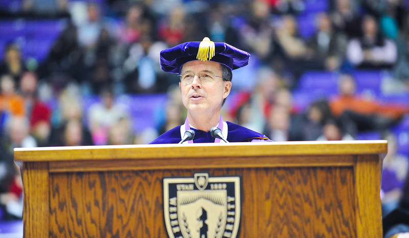 President of WSU Dr. Charles A. Wright opens with a speech at the 2013 Commencement Exercises.  At Dee Events Center, on December 13 2013.(Brian Wolfer Special to the Standard-Examiner)
