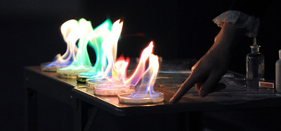 Weber State Chemistry instructor Michelle Paustenbaugh demenstrates different color reactions of fire. At Weber State, in Ogden. On December 16 2013.(Brian Wolfer Special to the Standard-Examiner)