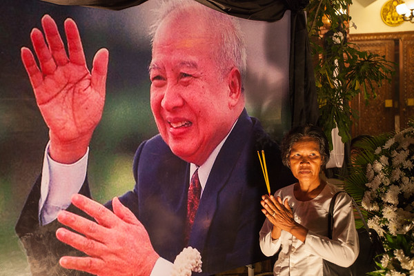 Posing with Sihanouk