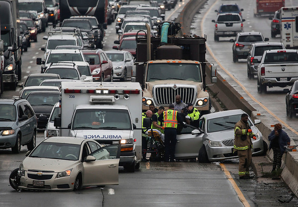 EMS personelle work the scene of an accident on Westbound I-30 near the 6th Street exit in Little Rock Friday, April 6, 2018.