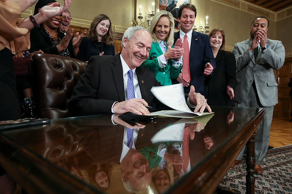 Arkansas Governor Asa Hutchinson Signs into law a bill to provide paid maternity leave to state workers at the State Capitol in Little Rock Thursday, February 16, 2017.