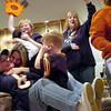 Carrie Pearce of Elwood hugs Kelly Sly of Crest Hill while Kelly's son Sammy, 7, plugs his ears to block out the cheering of the adults when they realized the Bears were going to the Superbowl at the New Lenox home of Jeff and Laura Pearce on Sunday.