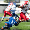 Youngstown State's Kevin Smith pulls away from Indiana State's Mike Woods at Memorial Stadium. Youngstown beat ISU 28-0.