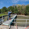 "April 25, 2012 - Scott Rossi, Interim Chief Operator of the Marlborough Wastewater Treatment Plant in Massachusetts, heads out to perform the daily check of solid waste levels at the bottom of one of the plant's settling tanks. The plant purifies 3 million gallons of water a day pumped from nearby towns and dumped by sewage trucks. Rossi admits, ""It's not a glamorous job...it's a vitally important job."" Photo by Christopher Weigl"