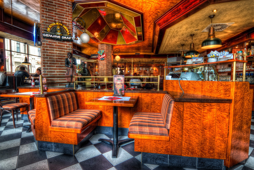 Steak House  I was in Cologne, Germany twice and both times I went to this Chicago Stake House for a great steak :). I had no tripod here and didn't really want everyone to know I'm taking a shot. So I just put the camera on the table in front of me, held it down and took the shots.  HDR from three shots, taken with Canon 450D with Sigma 10-20mm lens, from a table :)