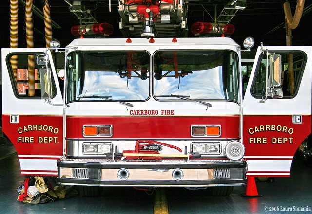 5-16-06- Tuesday-- my evening photography - portrait- class was  at the carrboro fire department.  got some great shots of the firemen.  here's one of the truck!