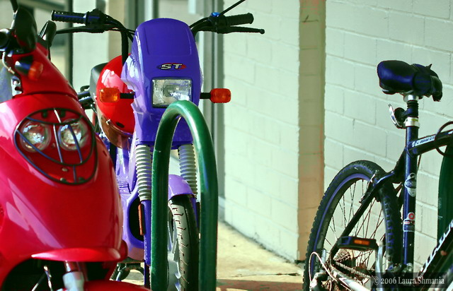 """6-19-06-- Monday<br /> <br /> variety at the bike rack<br /> <br /> """"the future belongs to those who see possibilities before they become obvious."""" <br /> <br />  <br /> john sculley, former ceo of apple computer"""