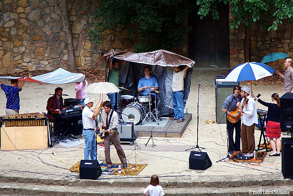 "6-22-08-- sunday and the band played on...  downpour did not deter the band or audience!   ""the old ceremony,"" a home-grown chapel hill band, in concert at the delightful forest theatre, an outdoor venue on the unc campus.  to see more photos:<a href=""http://butterflites.smugmug.com/gallery/5234748_EJCn2#318037165_YybPV"">click here</a> band's website: http://www.theoldceremony.com/"