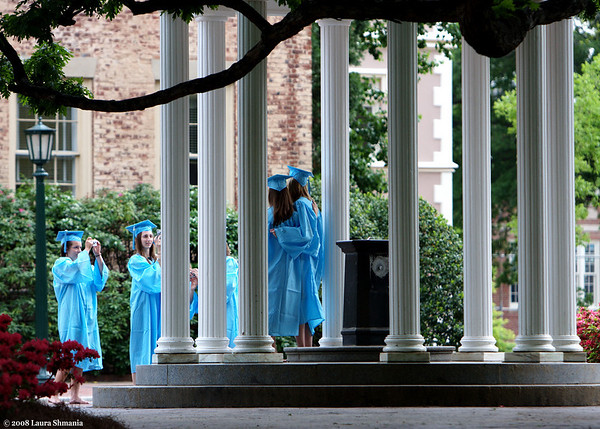 "5-5-08-- monday<br /> unc grads in front of the old well<br /> <br /> ""start by doing what's necessary,<br /> then what's possible, <br /> and suddenly you are doing the impossible.""<br /> <br /> -- saint francis of assisi"