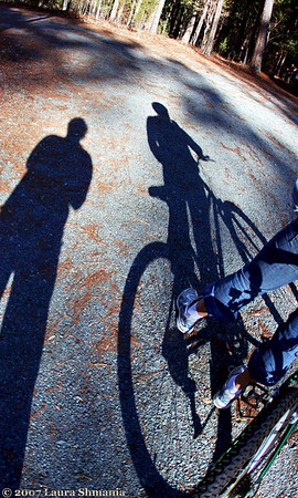 "1-1-08-- Tuesday<br /> happy new year!  <br /> me and my daughter (through a fish-eye lense) <br /> after our 17-mile bike ride this afternoon!  <br /> <br /> ""it is by riding a bicycle that you learn the contours of a country best, since you have to sweat up the hills and coast down them.  thus you remember them as they actually are, while in a motor car only a high hill impresses you, and you have no such accurate remembrance of country you have driven through as you gain by riding a bicycle.""<br /> <br /> -- ernest hemingway"