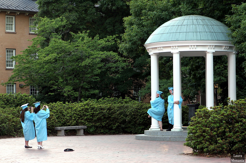 "5-14-07-- Monday<br /> UNC-Chapel Hill grads hugging <br /> the Old Well!<br /> <br /> ""to acquire knowledge, <br /> one must study; <br /> but to acquire wisdom, <br /> one must observe.""<br /> <br /> -- marilyn vos savant"