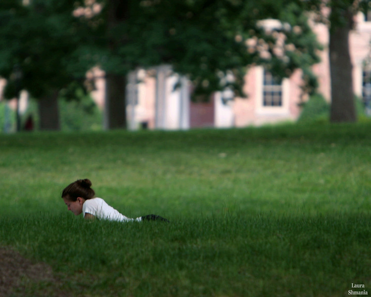 """5-29-07-- Tuesday<br /> studying on the quad in front of the Old Well<br /> <br /> """"it is important that students bring a certain ragamuffin, barefoot irreverence to their studies; they are not here to worship what is known, <br /> but to question it.""""  <br /> <br /> -- jacob bronowski"""