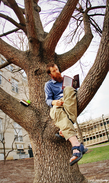 "3-19-09-- thrusday<br /> another beautiful day - came across this fellow reading in a the tree on campus- he agreed to let me take his photo...<br /> <br /> <br /> ""if March comes in like a lion, it will go out like a lamb."" <br /> <br /> -- proverb"
