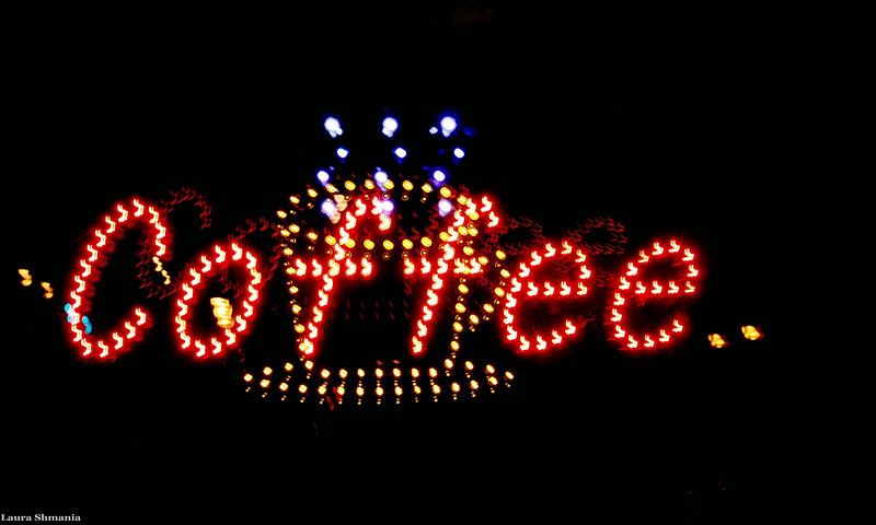 "6-12-09-- saturday<br /> long exposure on a flashing sign that alternated the coffee cup and the word ""coffee""- got them both simultaneously!<br /> <br /> ""if this is coffee, please bring me some tea; but if this is tea, please bring me some coffee.""<br /> <br /> -- abraham lincoln"