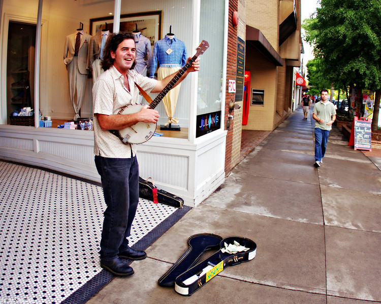 "5-2-09-- friday<br /> musician on franklin street<br /> <br /> ""music is the poetry of the air.""<br /> <br /> -- richter"